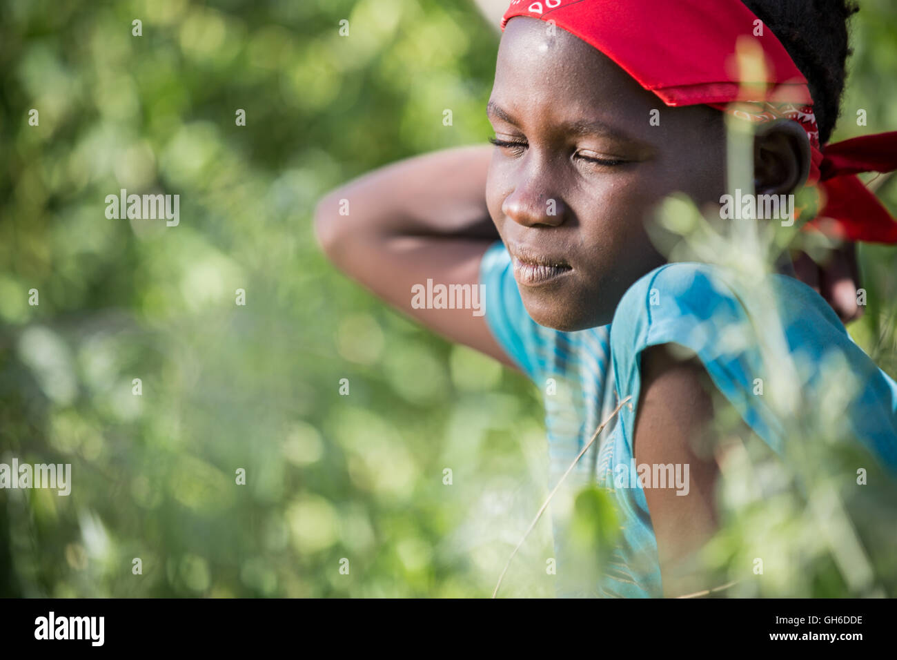 Daydream - Young Girl from Nyangatom (Bume) Tribe in Ethiopia. Stock Photo