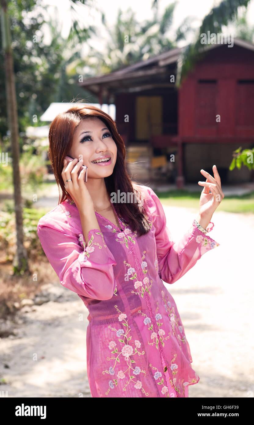 Beautiful Asian Malay Lady In Traditional Costume Baju Kebaya Stock