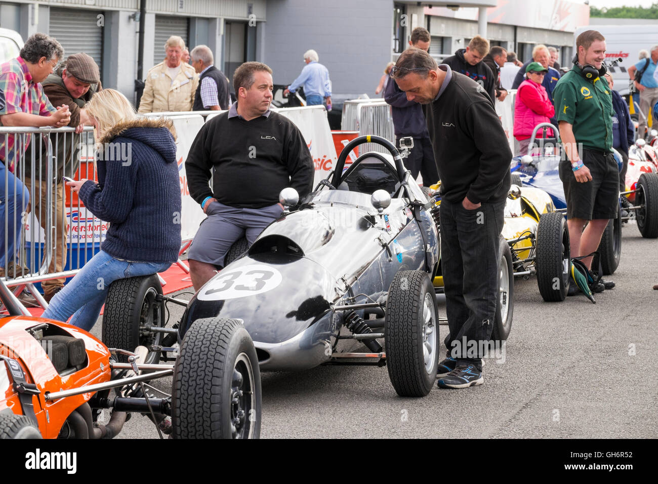 Formula Junior racing cars lined up in the paddock, 2016 Silverstone Classic event, England, UK - Stock Image