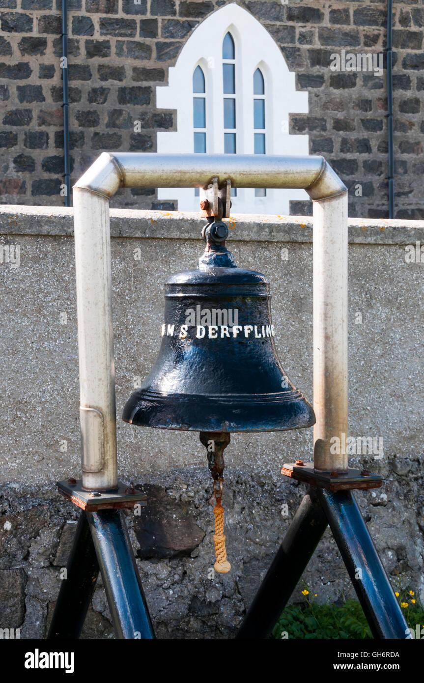 The bell of the German battlecruiser SMS Derfflinger outside the church of St Michael on the island of Eriskay. - Stock Image