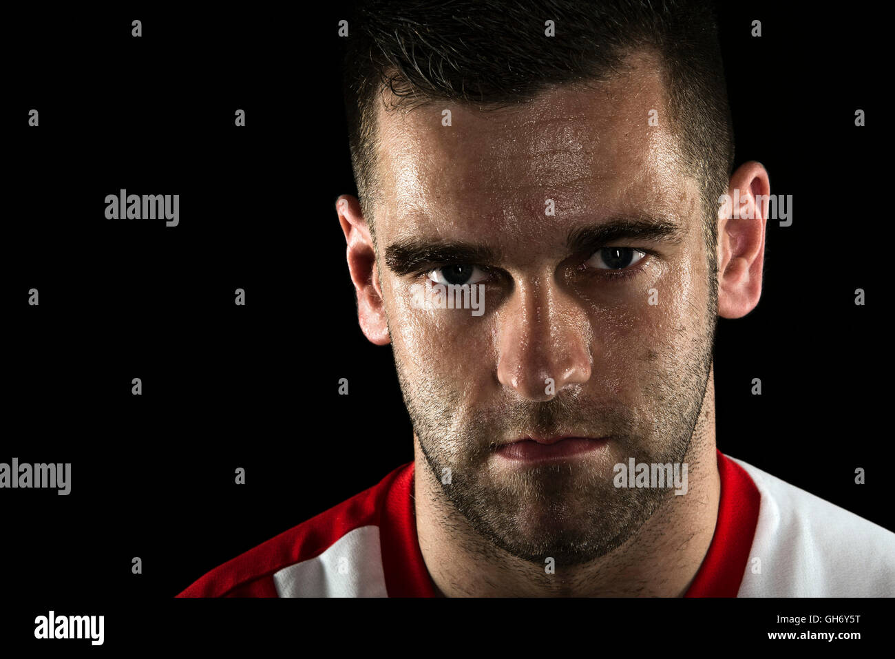 Football soccer player athlete  head shot portrait  wet face sweating - Stock Image