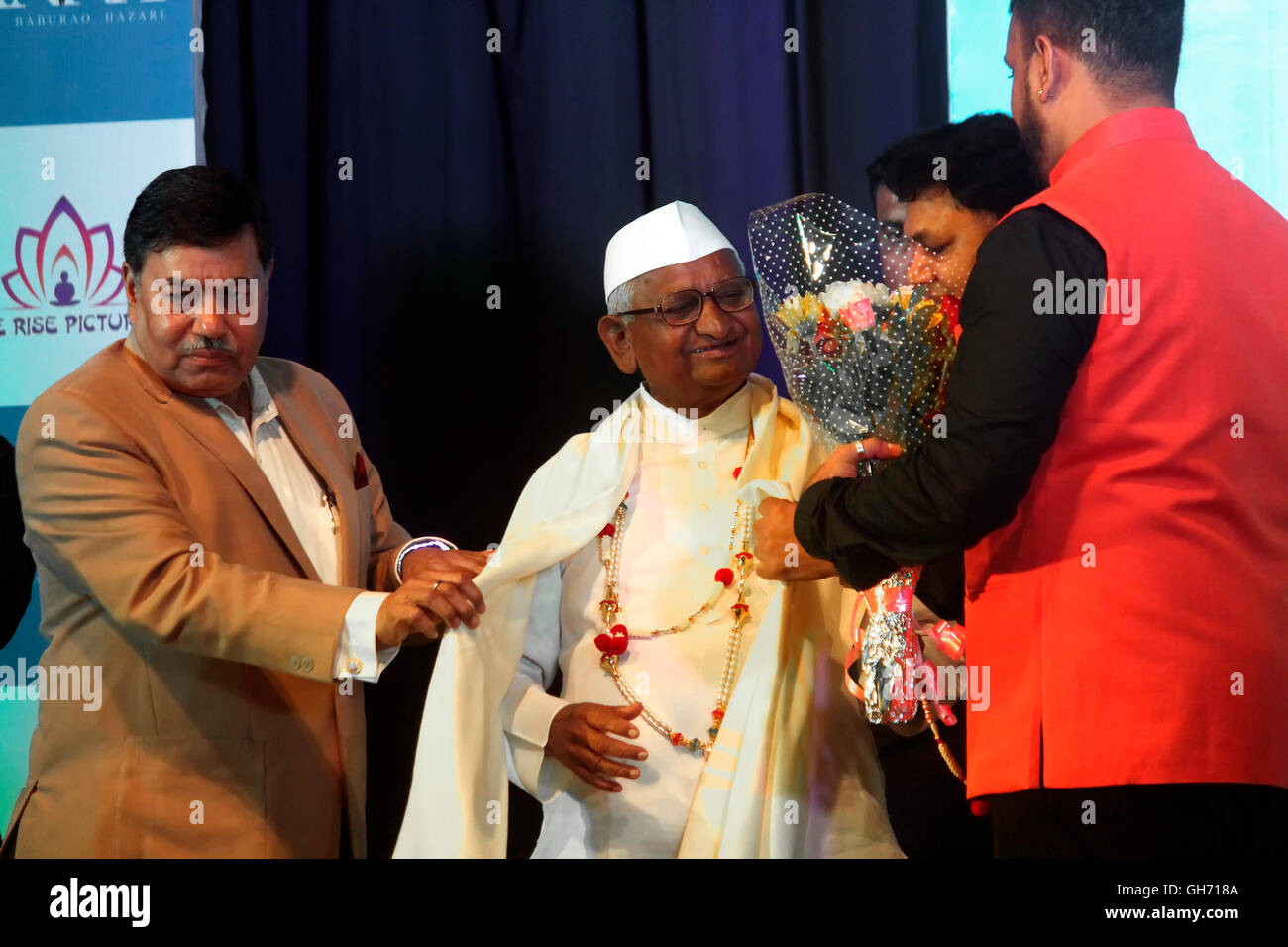 Anna Hazare being felicitated by flowers and shawl at the poster unveiling ceremony of an upcoming biopic. - Stock Image