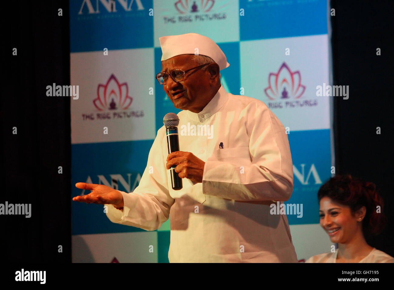 Famous Personality Anna Hazare saying a few words of wisdom on the poster launch ceremony of an upcoming biopic - Stock Image