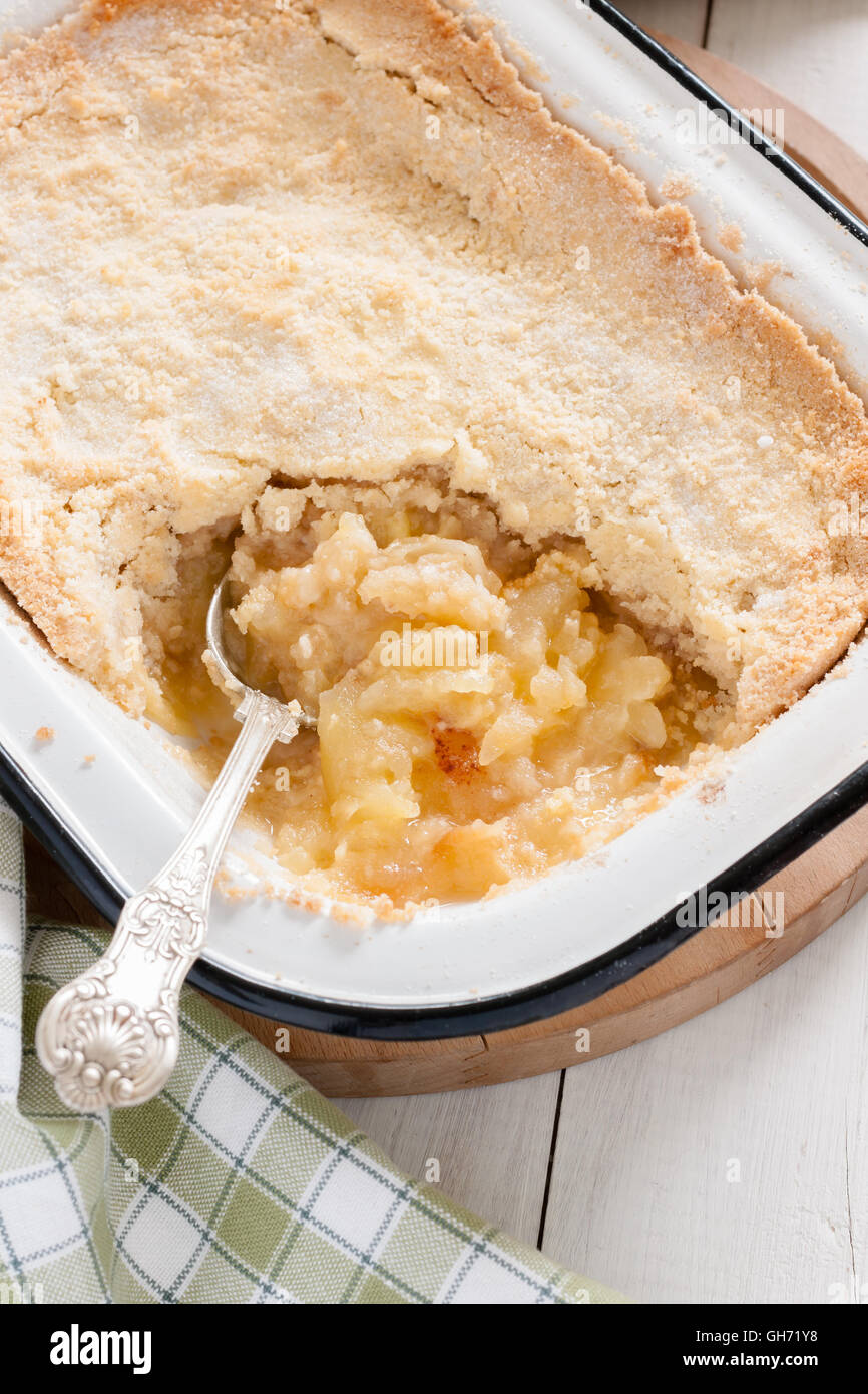 Home made Bramley apple crumble or apple cobbler stewed fruit with a crunchy topping - Stock Image