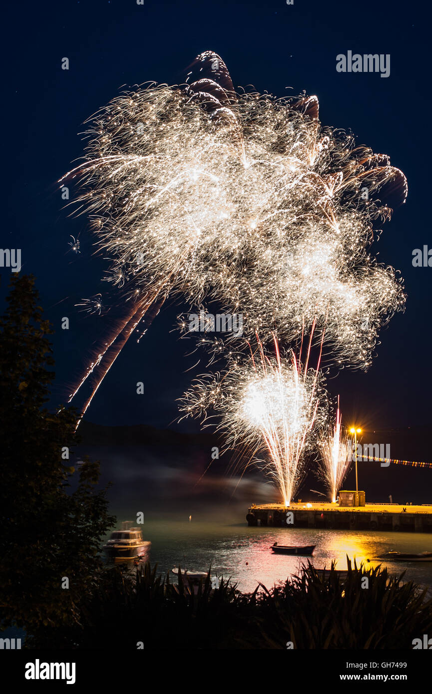 The annual Schull Regatta culminated in a firework display. The fireworks were launched from Schull Harbour, West - Stock Image
