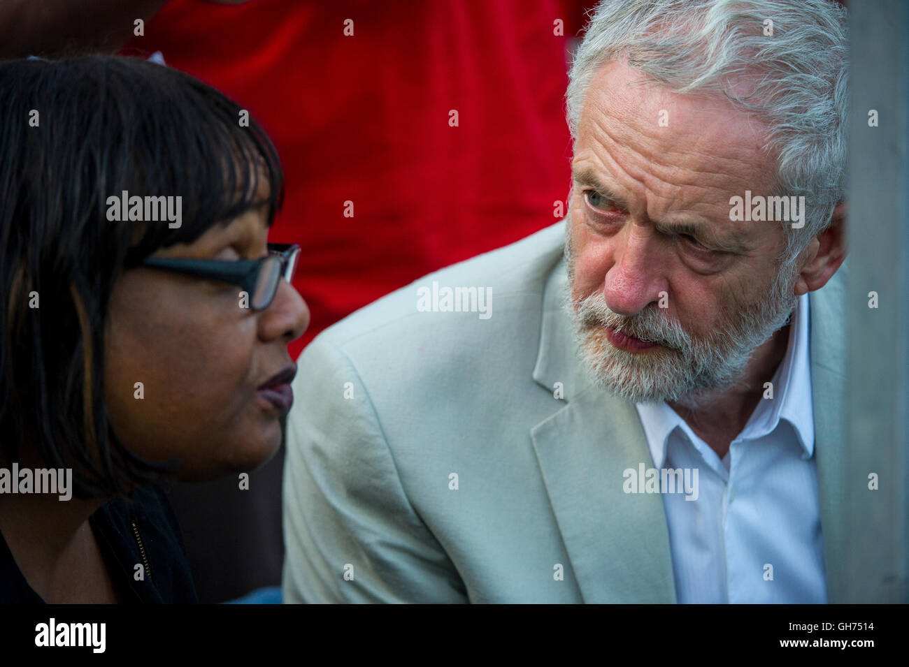 Labour Party leader Jeremy Corbyn speaks to Diane Abbott as he waits to address his supporters on College Green - Stock Image