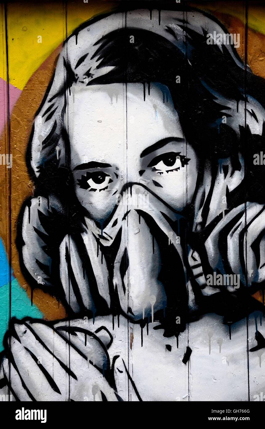 Street art wall mural graffiti of woman wearing oxygen gas mask london england