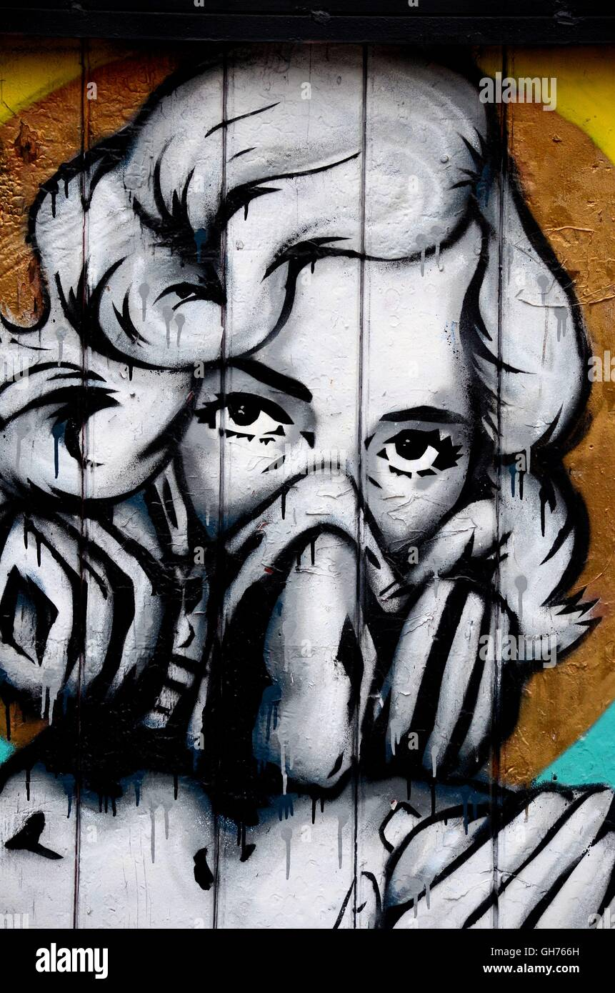 Street art wall mural graffiti of woman wearing gas oxygen mask london england
