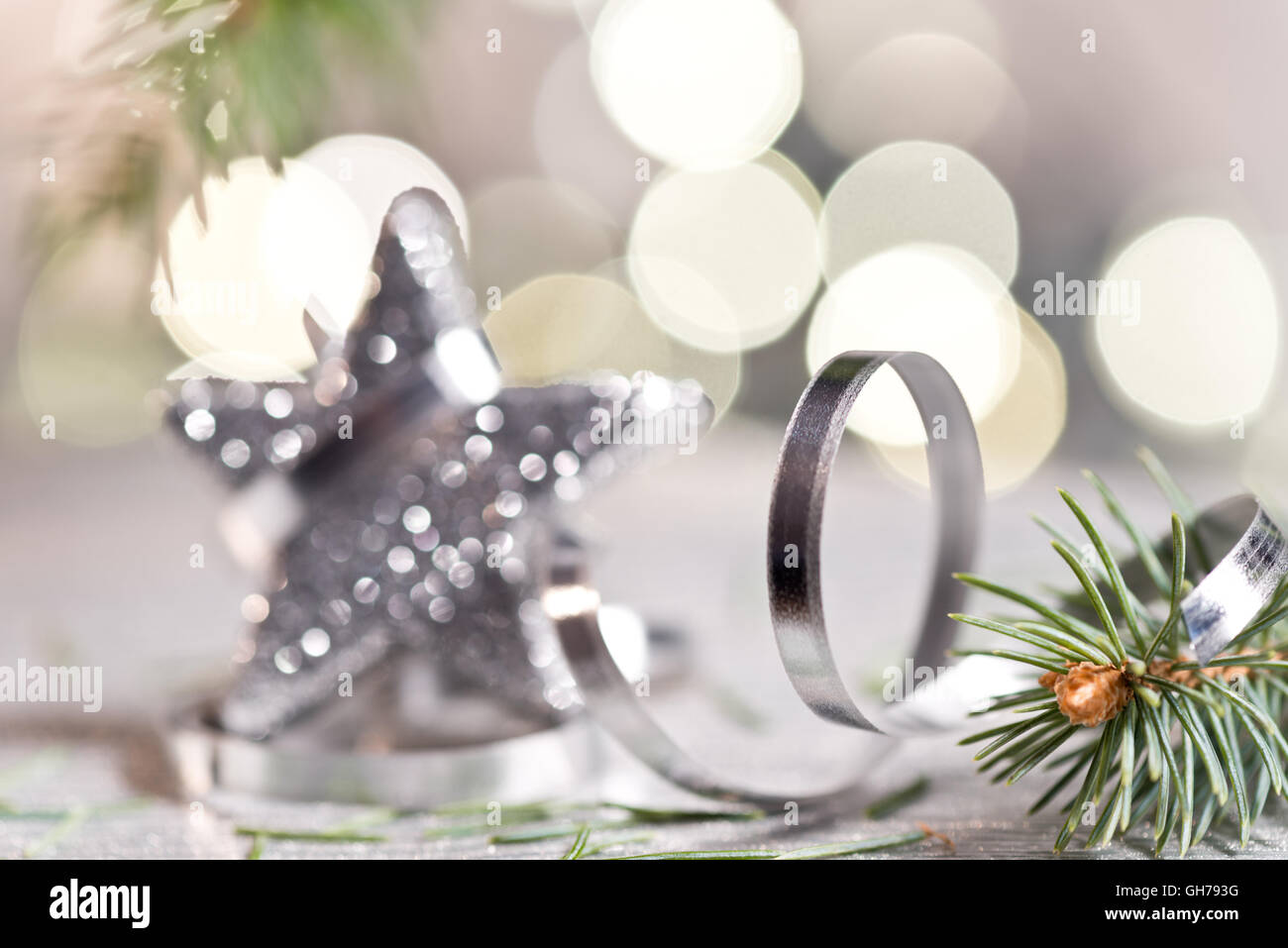 Silver Christmas star with needles and christmas decoration - Stock Image