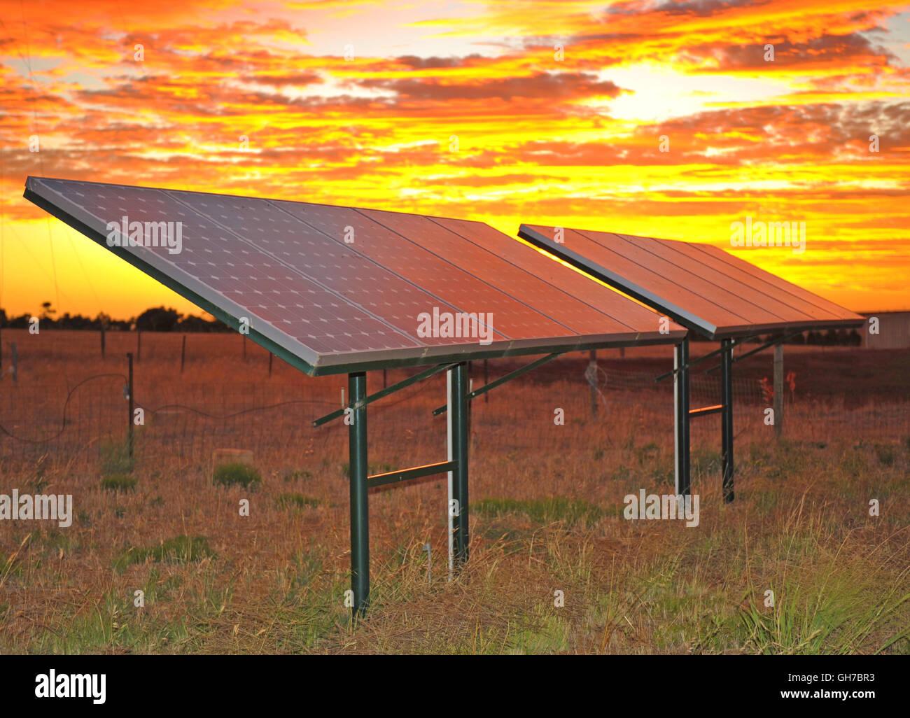 Sunset Solar Panels - Stock Image