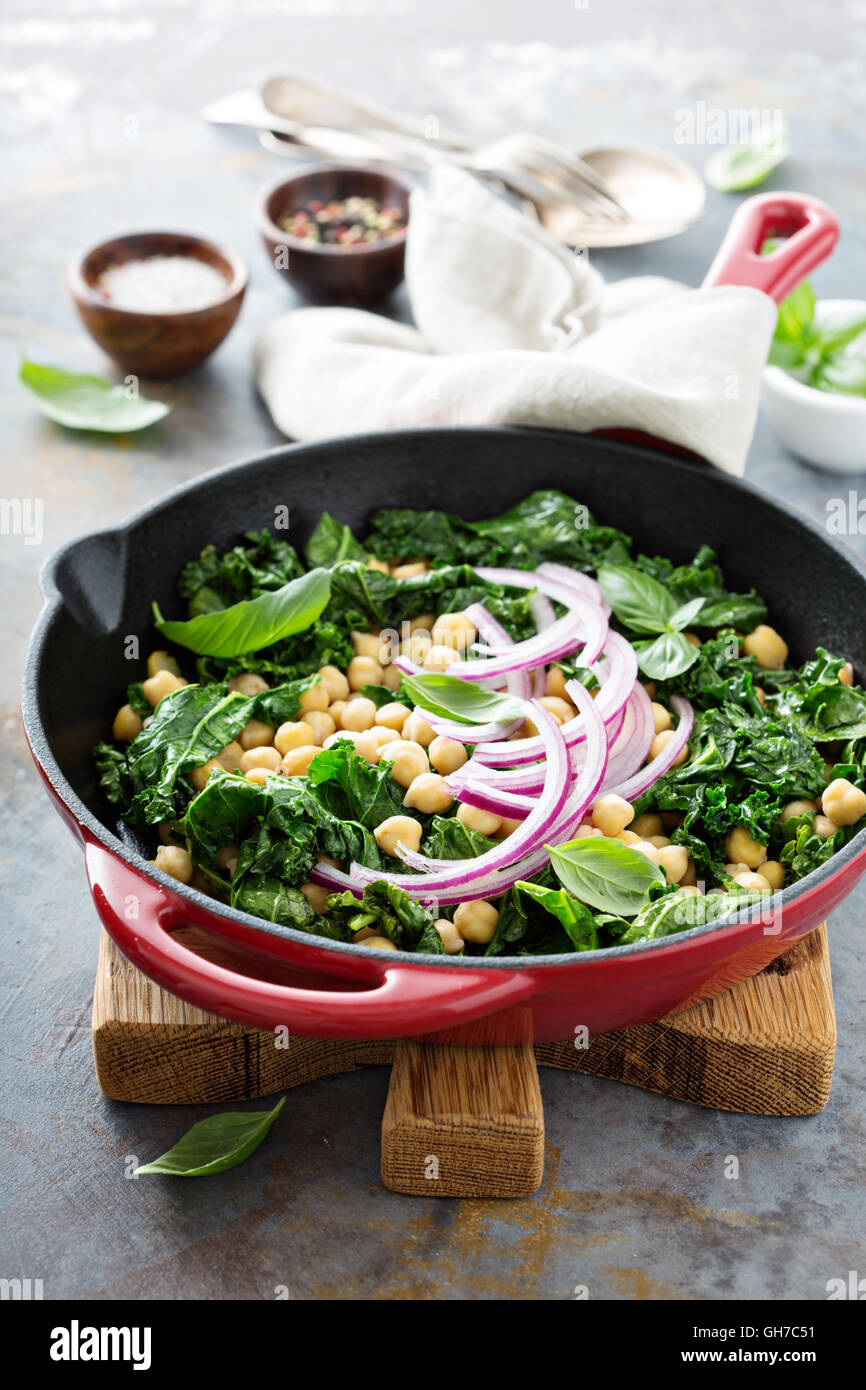 Sauteed kale with chickpeas and red onion - Stock Image