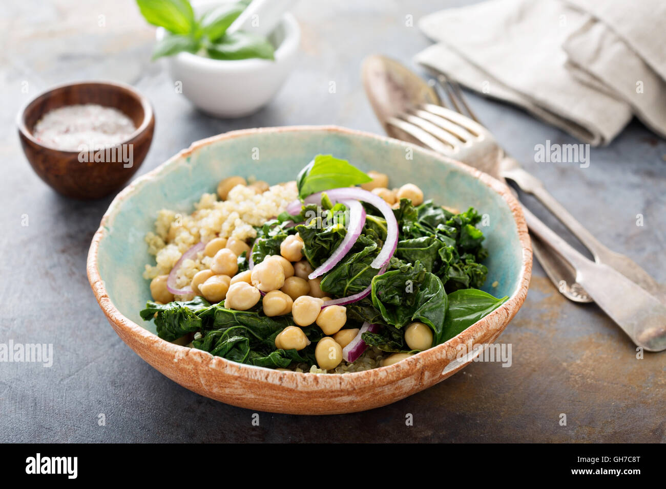Warm salad with kale, chickpeas and quinoa - Stock Image