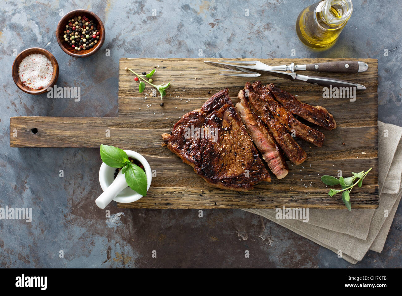 Ribeye steak on a cutting board top view - Stock Image
