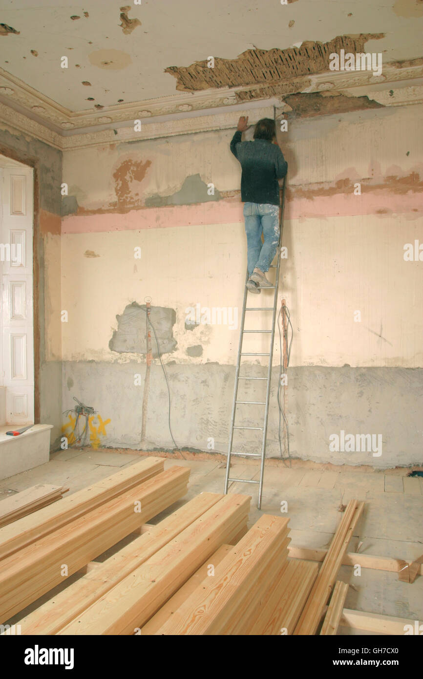Property developers workman working on refurbishment of old house. - Stock Image