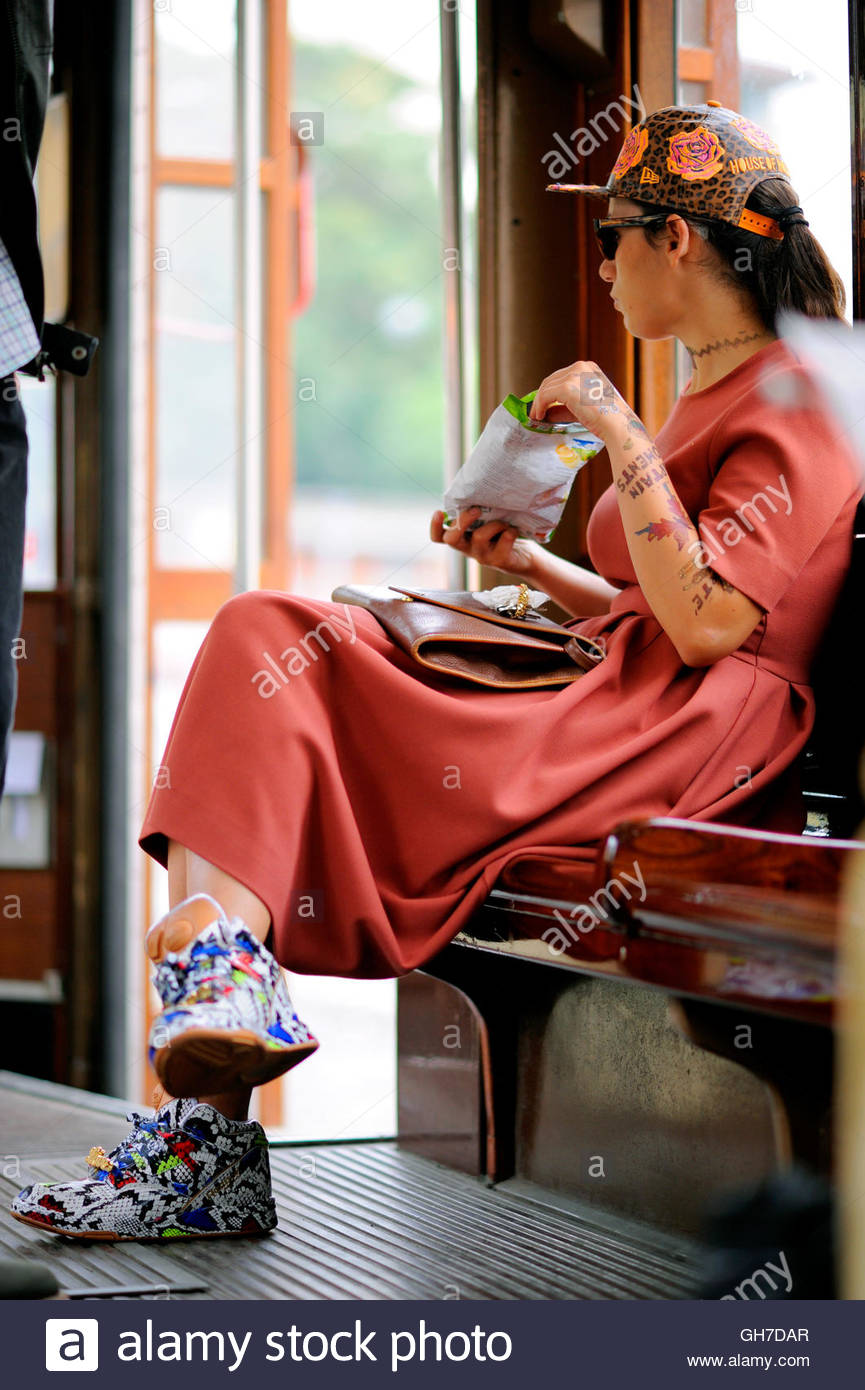 Woman on a tram during Milan Fashion Week. - Stock Image