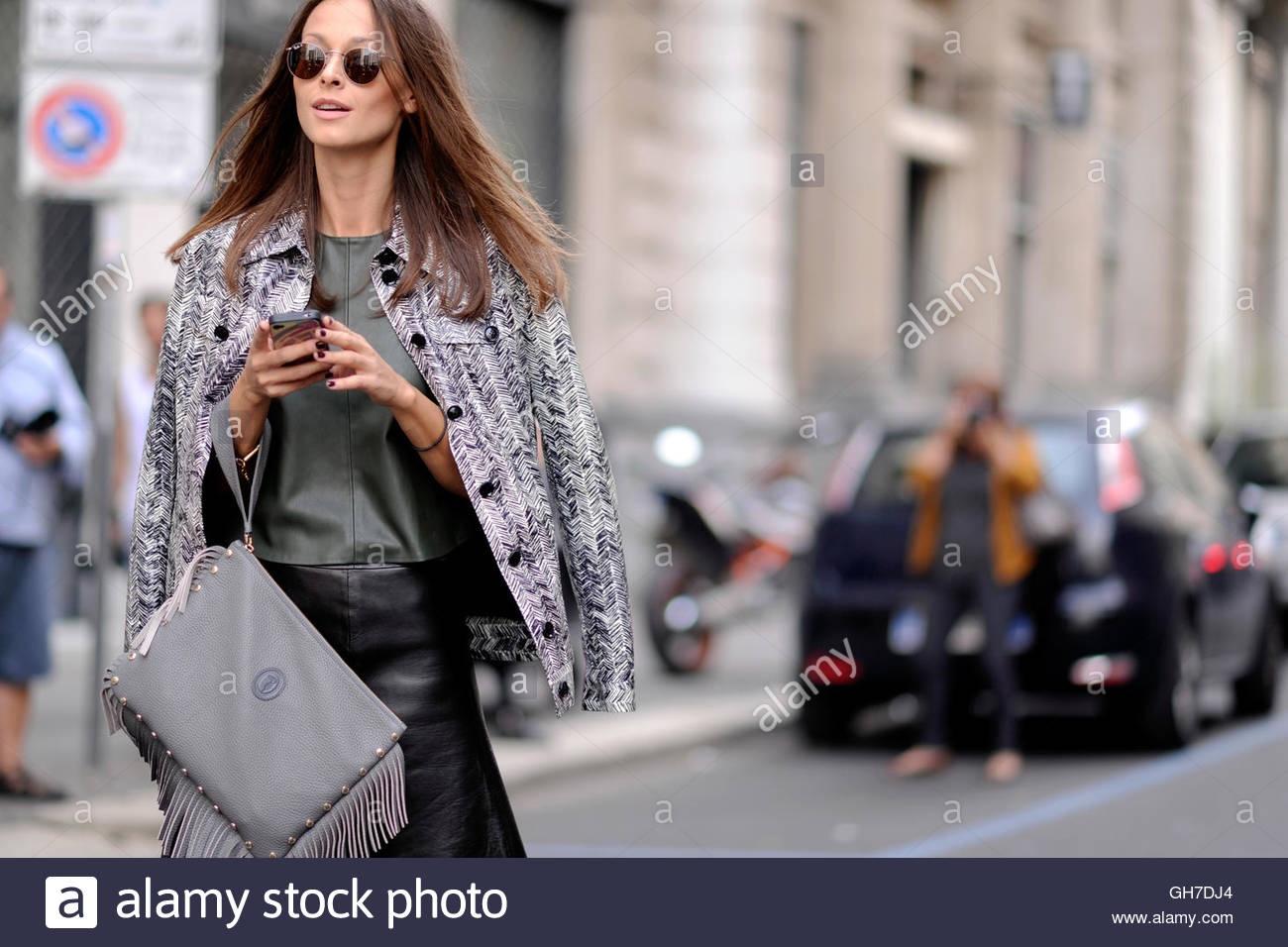 Woman attends Milan Fashion Week, Italy. - Stock Image