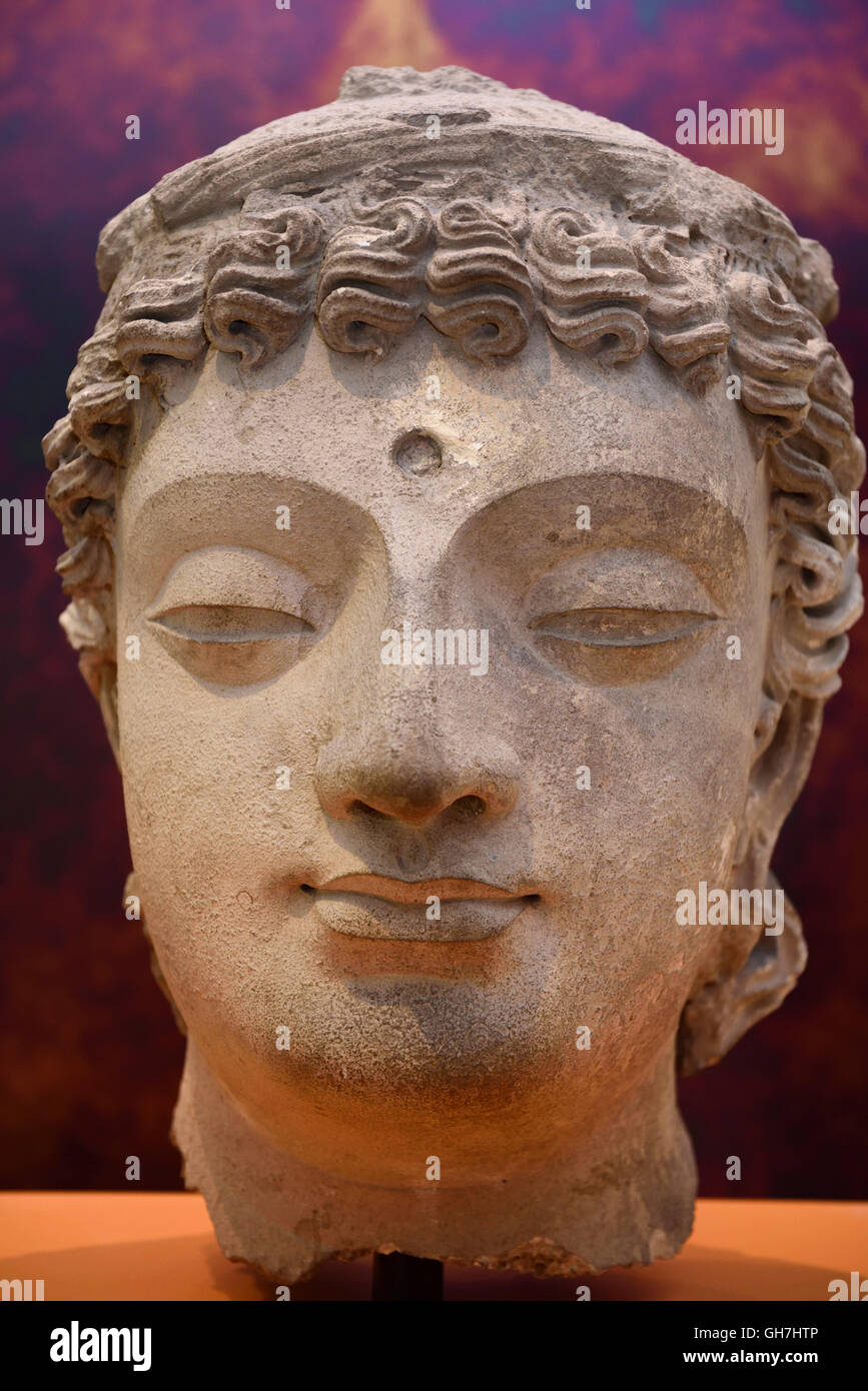 Carved plaster head of a Bodhisattva 4th 5th century Gandhara Pakistan at ROM Royal Ontario Museum Toronto - Stock Image