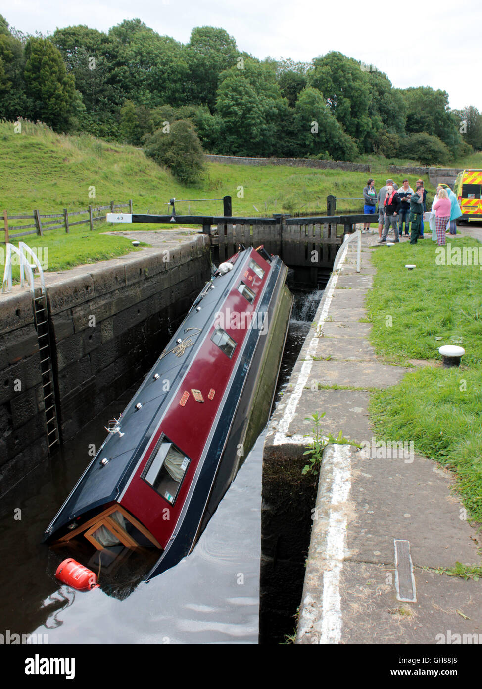 A holiday hire narrow boat has sunk in a lock on the Leeds and Liverpool canal near Greenberfield, Lancashire England - Stock Image