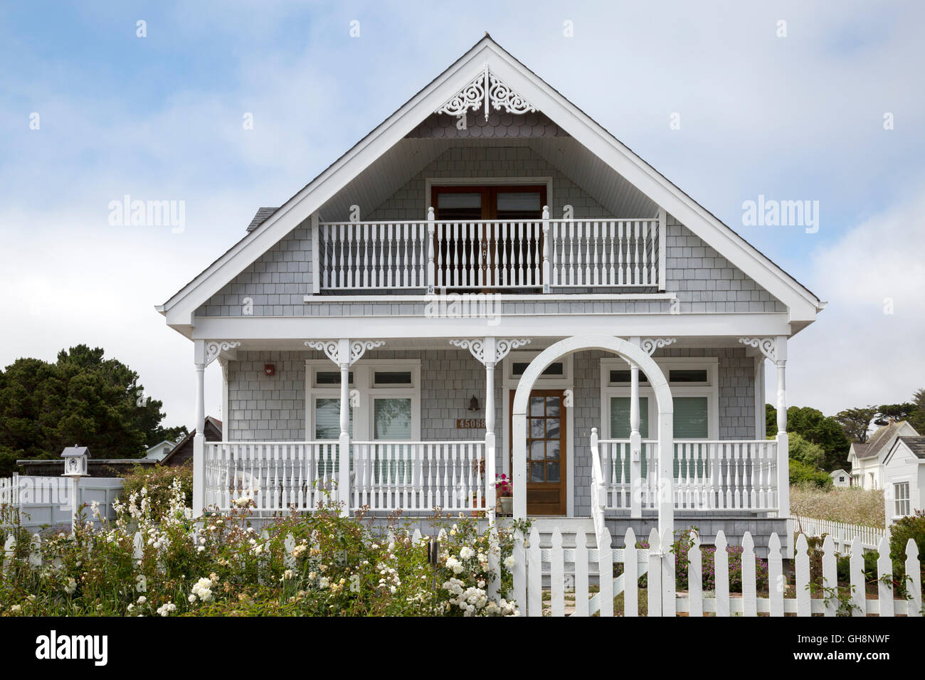 Cute Victorian home with picket fence and flowers in Mendocino, California. - Stock Image