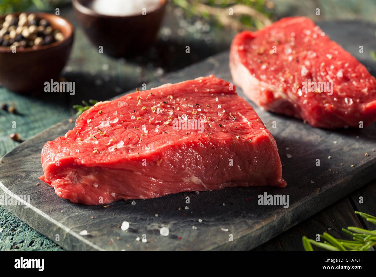 Raw Organic Grass Fed Sirloin Steak with Salt and Pepper - Stock Image