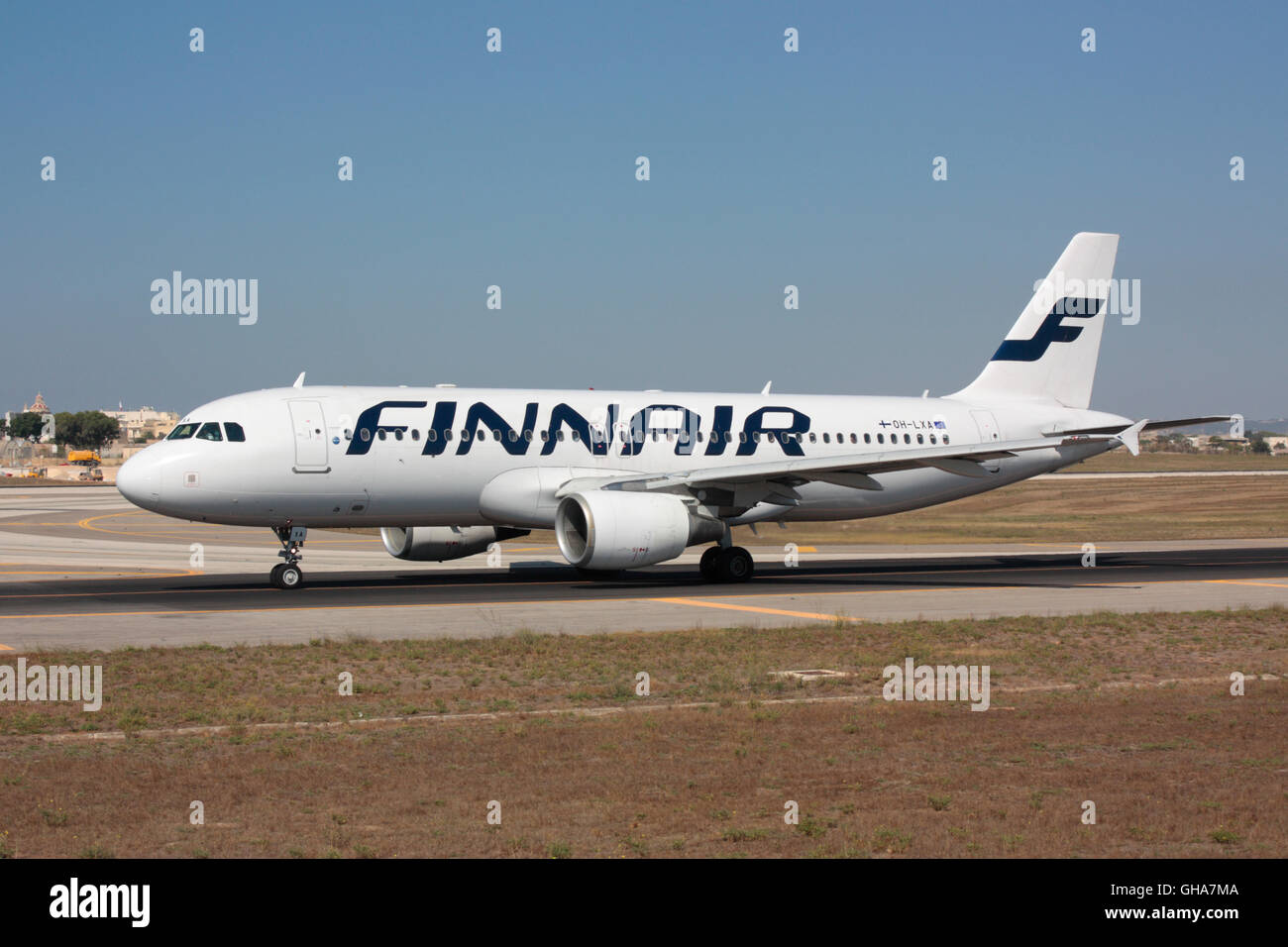 Air travel. Finnair Airbus A320 taxiing for departure from Malta - Stock Image