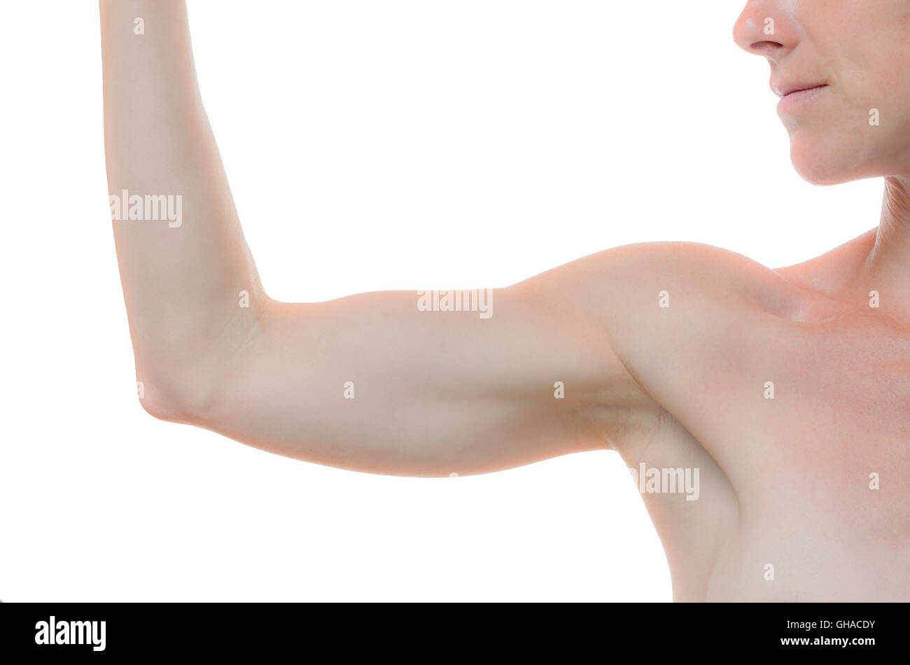 Bare shoulder and arm bent at the elbow of one woman against a white background - Stock Image