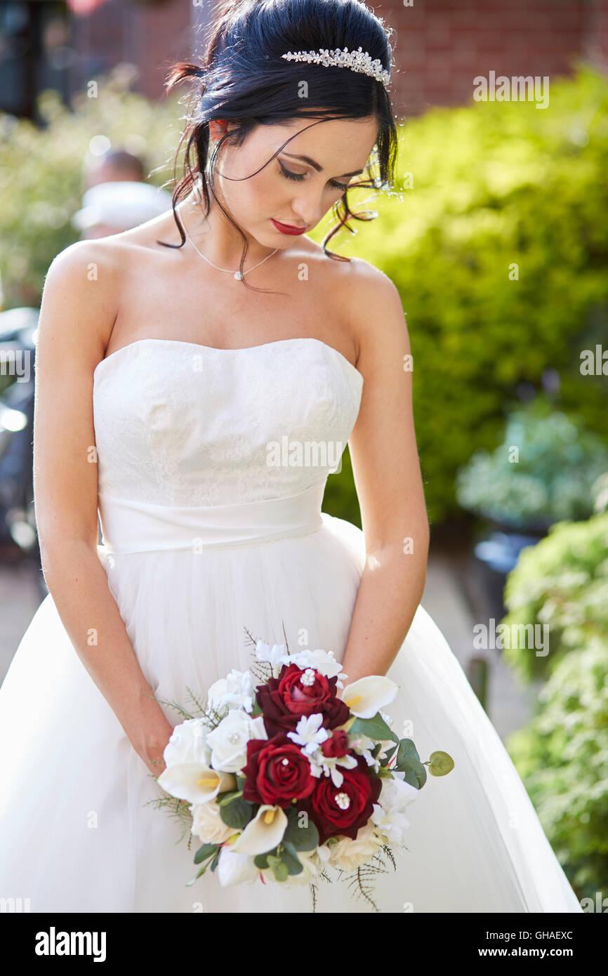 Unhappy bride at wedding - Stock Image