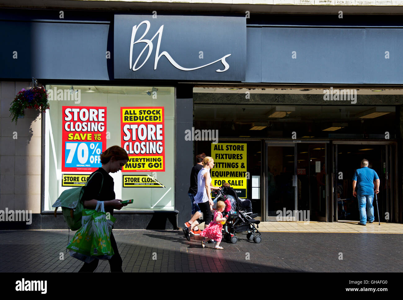 People walking past branch of BHS, British Home Stores, holding closing down sale, Middlesborough, North Yorks, - Stock Image