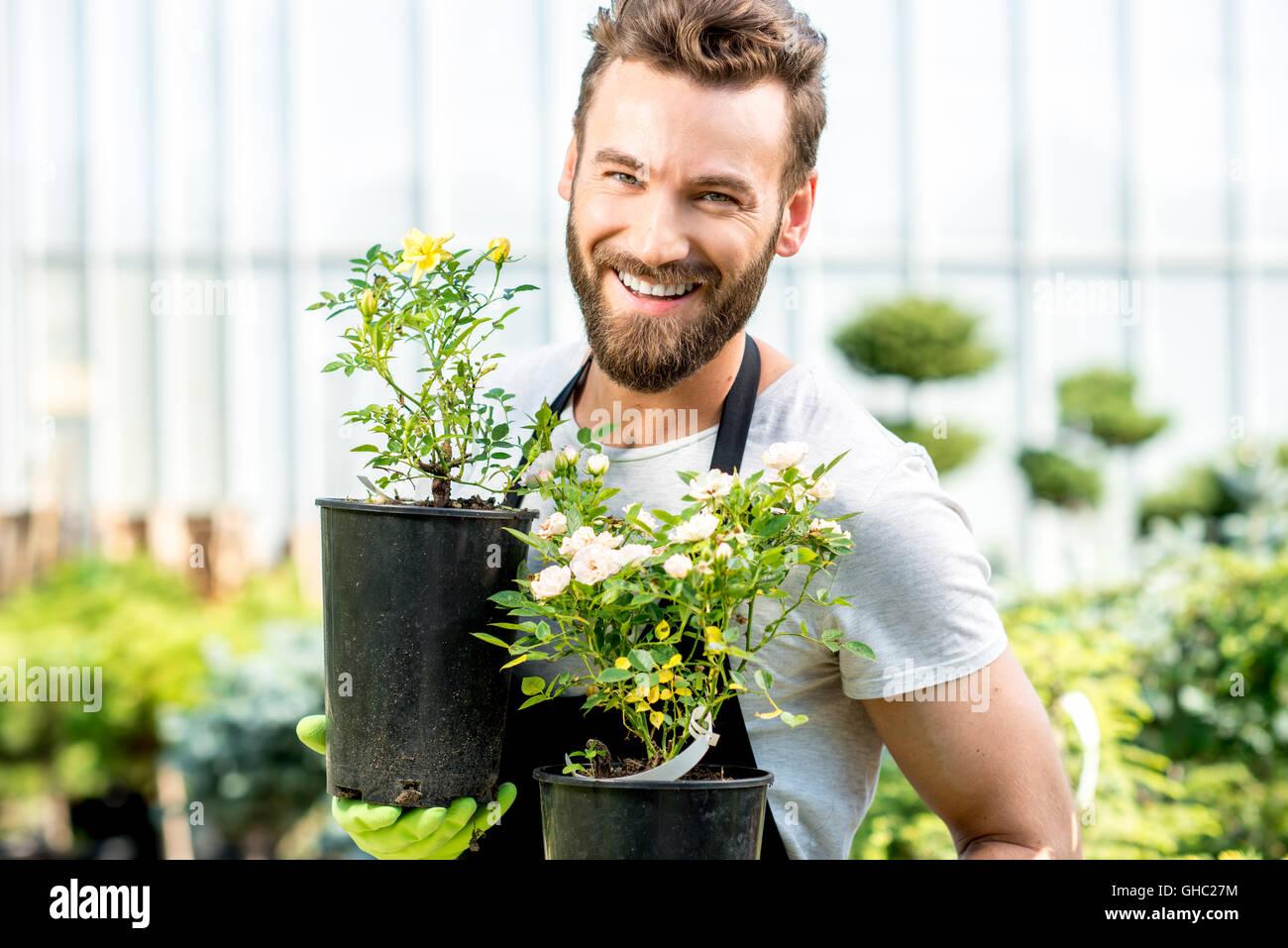 Gardener with a flowerpot - Stock Image