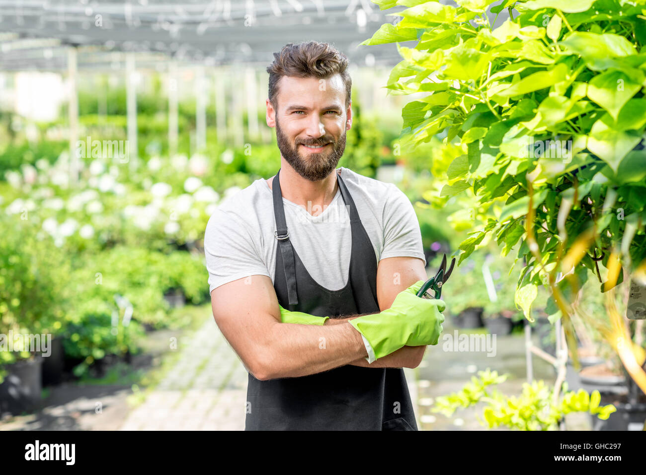 Portrait of handsome gardener - Stock Image