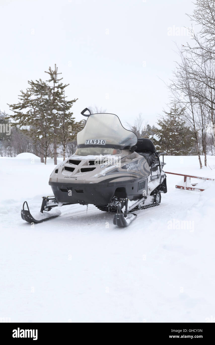 A snowmobile in arctic conditions - Stock Image