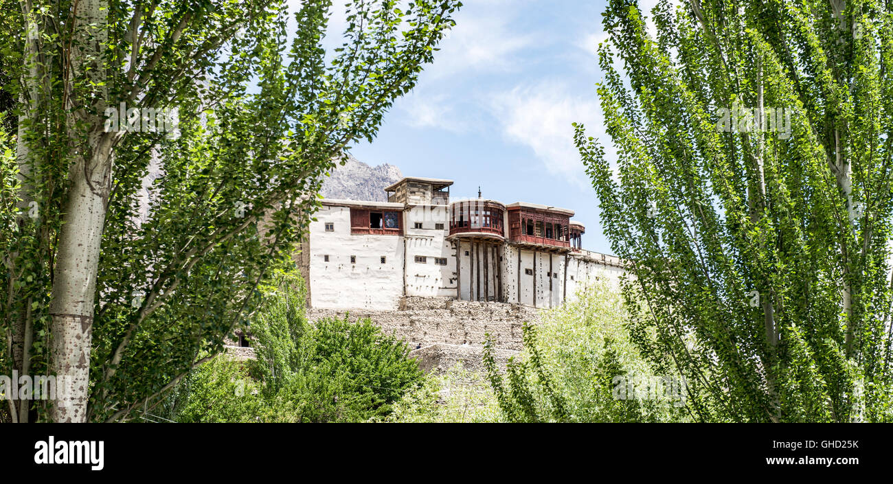 Baltit fort in Karimabad framed by poplar trees - Stock Image