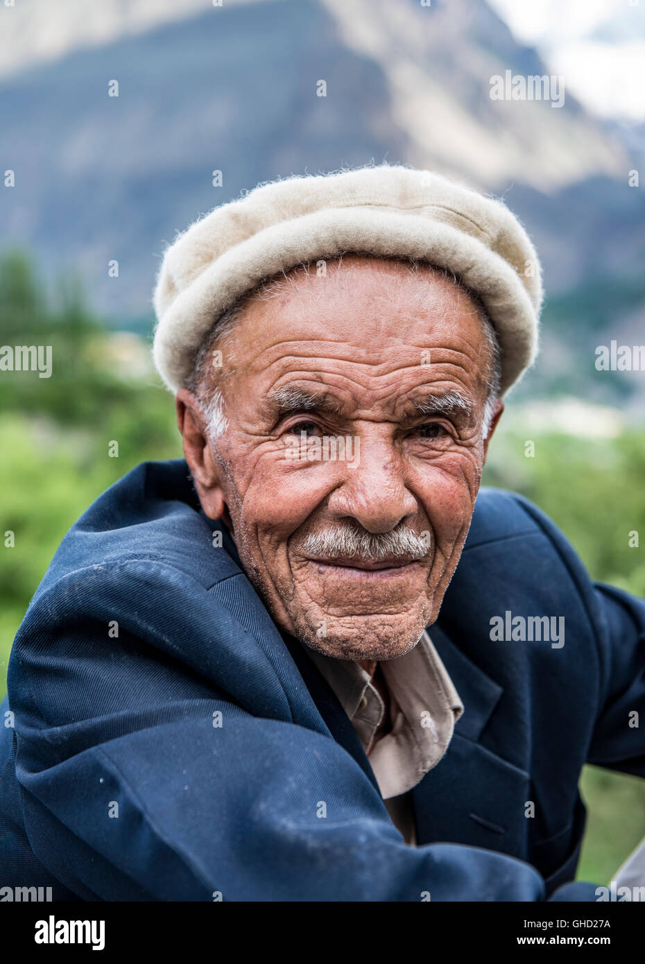 Man with moustache wearing traditional Hunza cap in Karimabad, northern Pakistan - Stock Image
