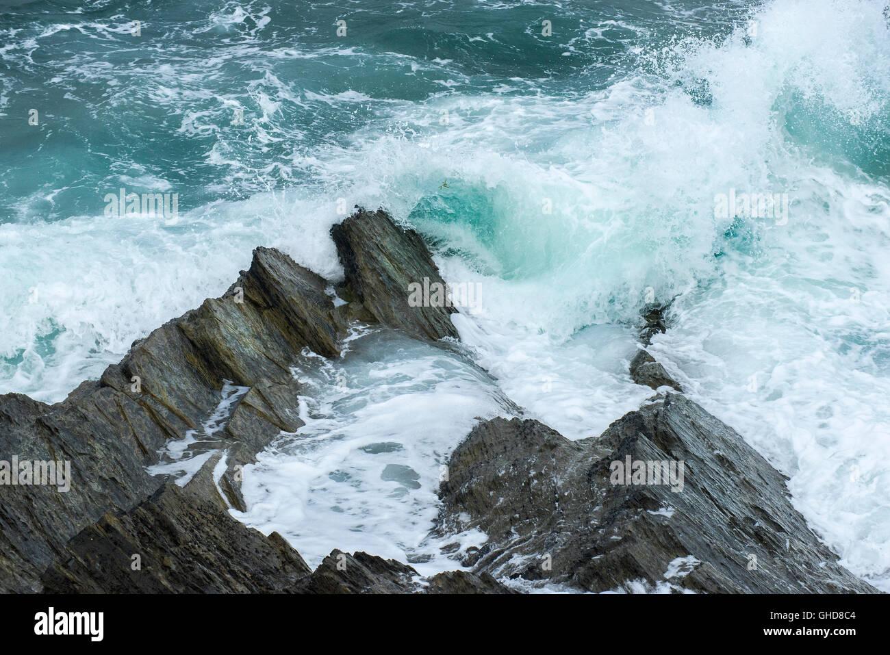 Waves crashing on rocks at Towan Headland in Newquay, Cornwall. Stock Photo