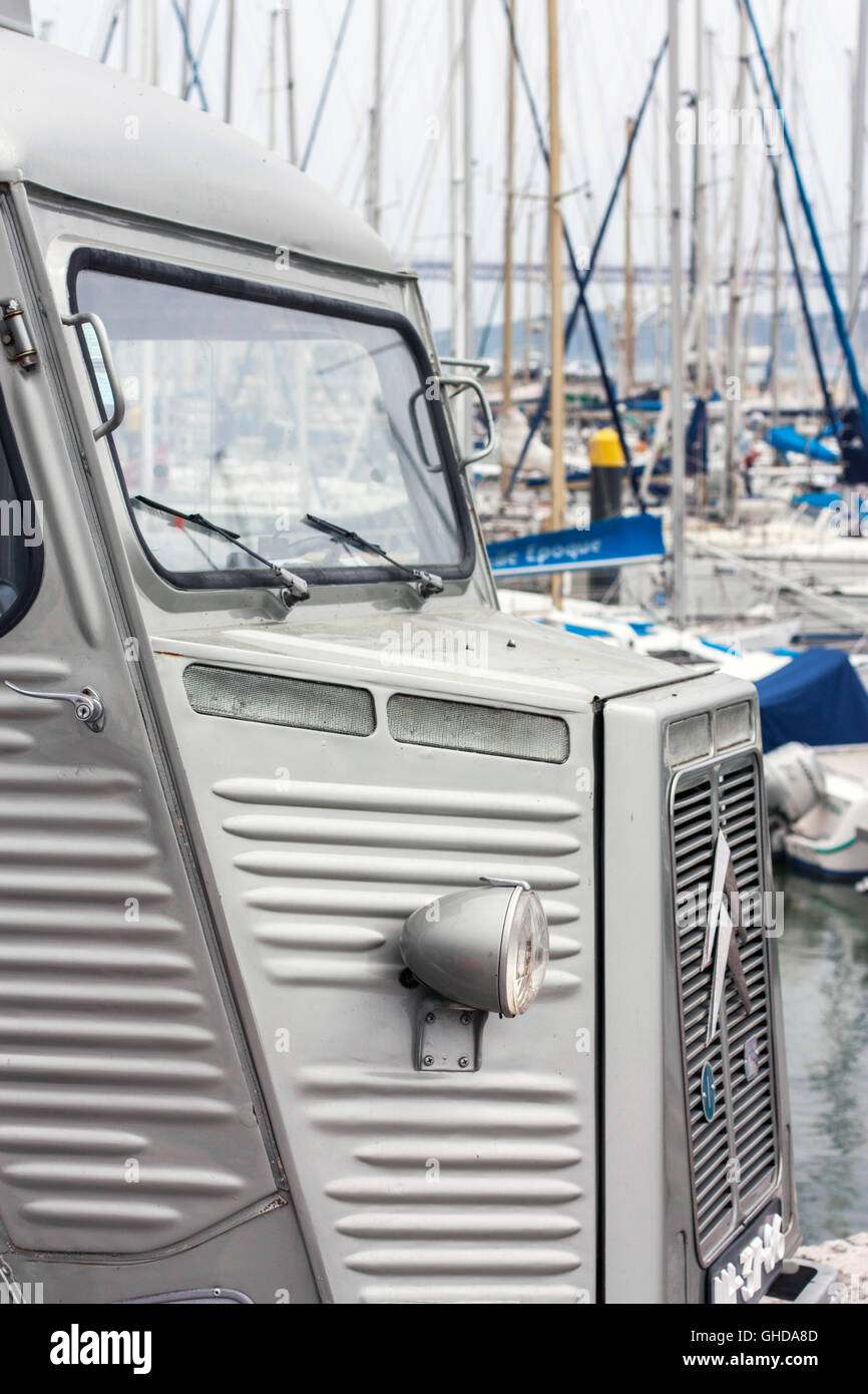 close up of vintage Citroen H van in front of boats in a marina Stock Photo