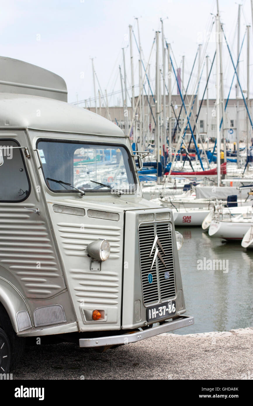 vintage Citroen H van in front of boats in a marina Stock Photo