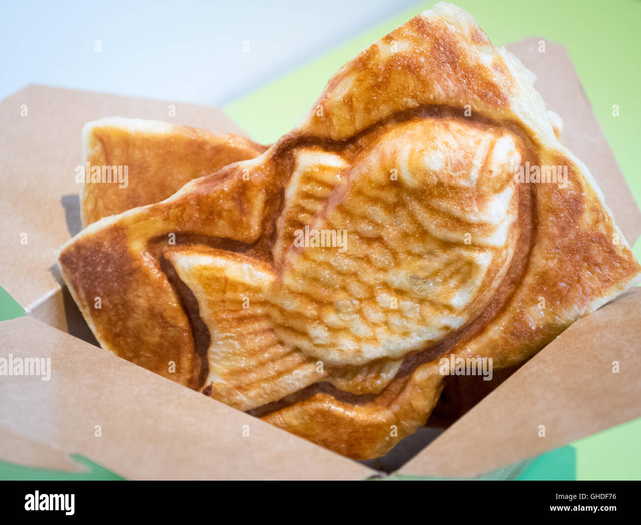 A taiyaki, a Japanese fish-shaped cake filled with red bean paste, from Snowy Village Dessert Cafe in Vancouver, - Stock Image