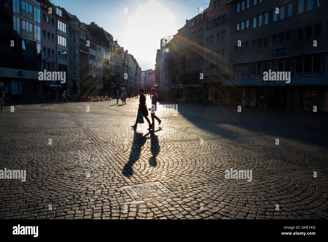 Shoppers stroll through the main square in Bonn, Germany. - Stock Image