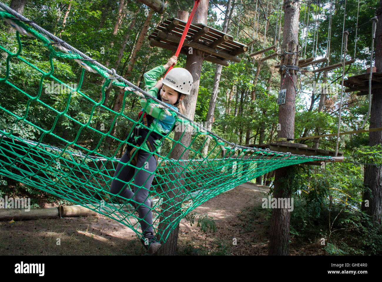 Young girl at a treetop adventure park in Germany. - Stock Image