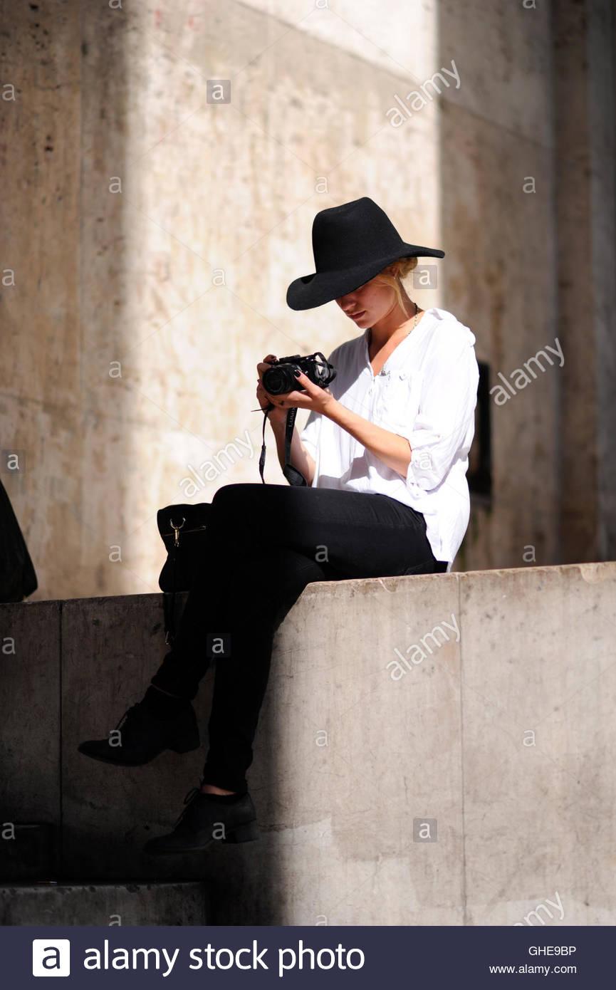A woman with camera at the  Palais de Tokyo Paris. Stock Photo