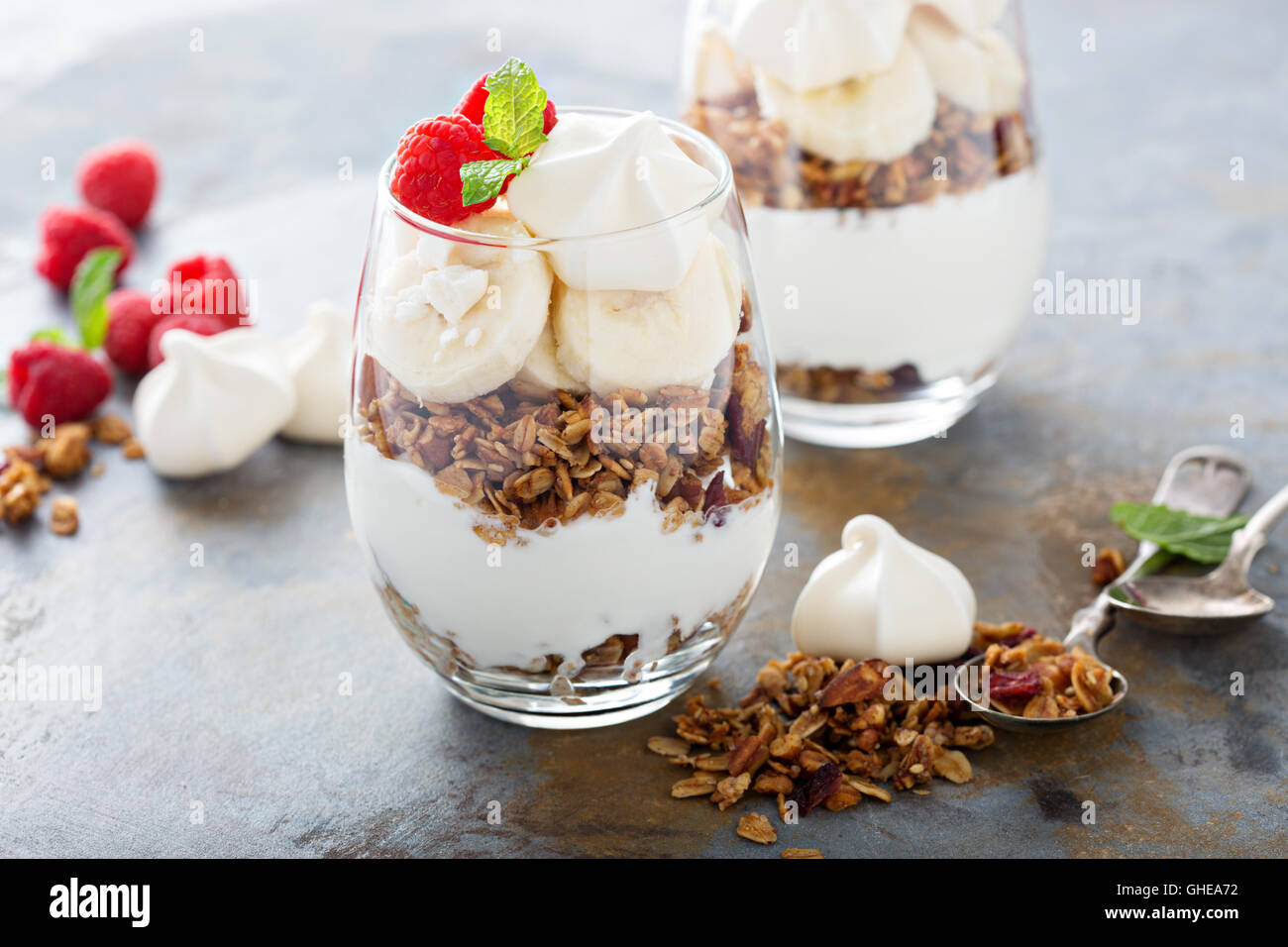 Banana and granola breakfast parfait - Stock Image