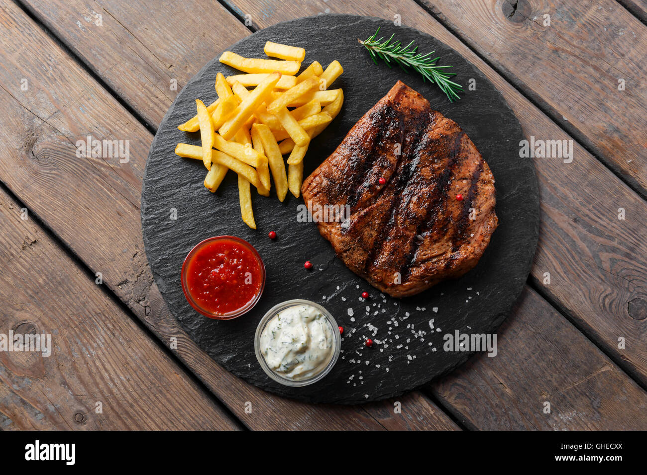 Beef steak with french fries and sauce - Stock Image