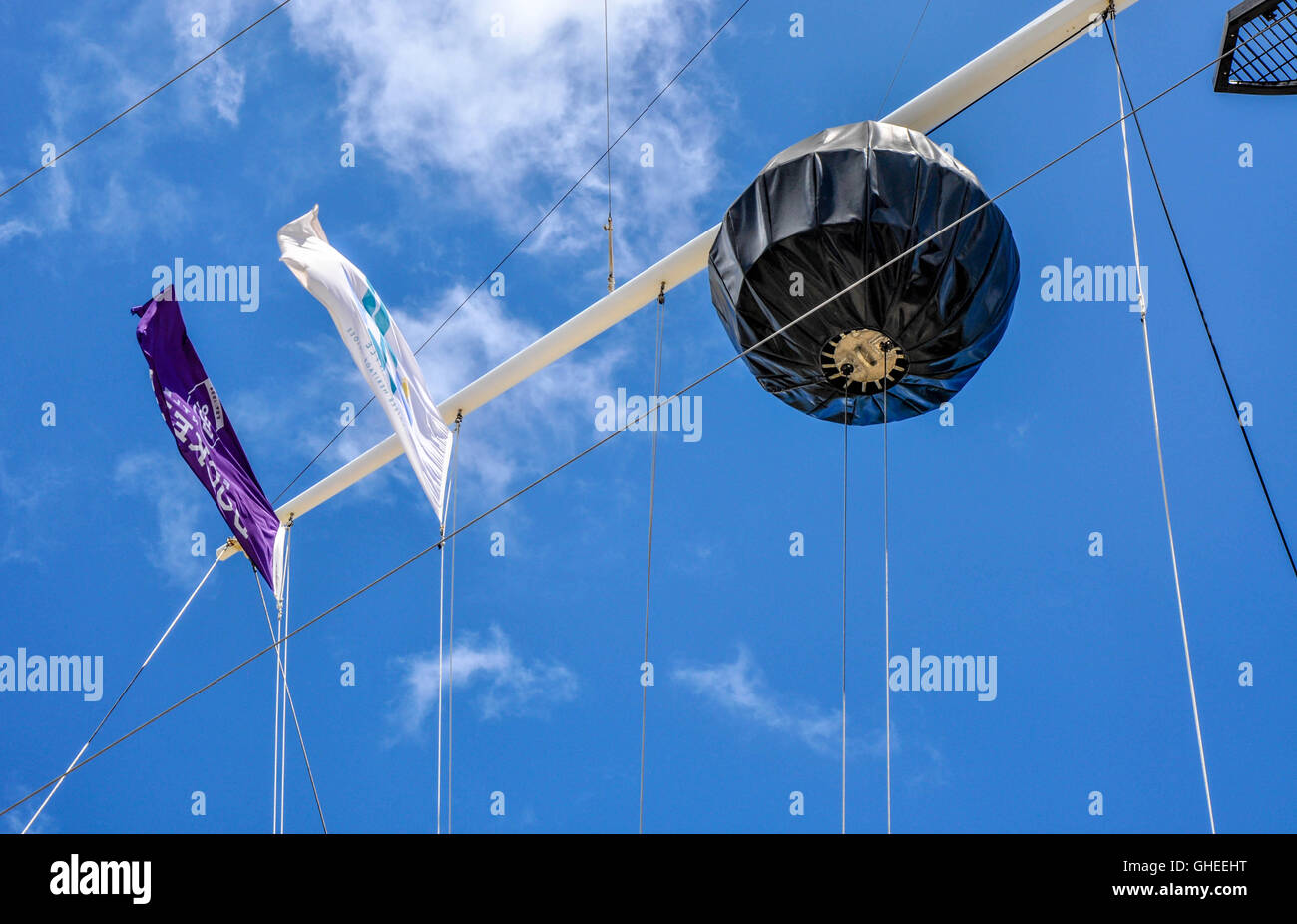 Flag array with large black time ball on flagpole on display at the Old Round House historic site in Fremantle,Western - Stock Image