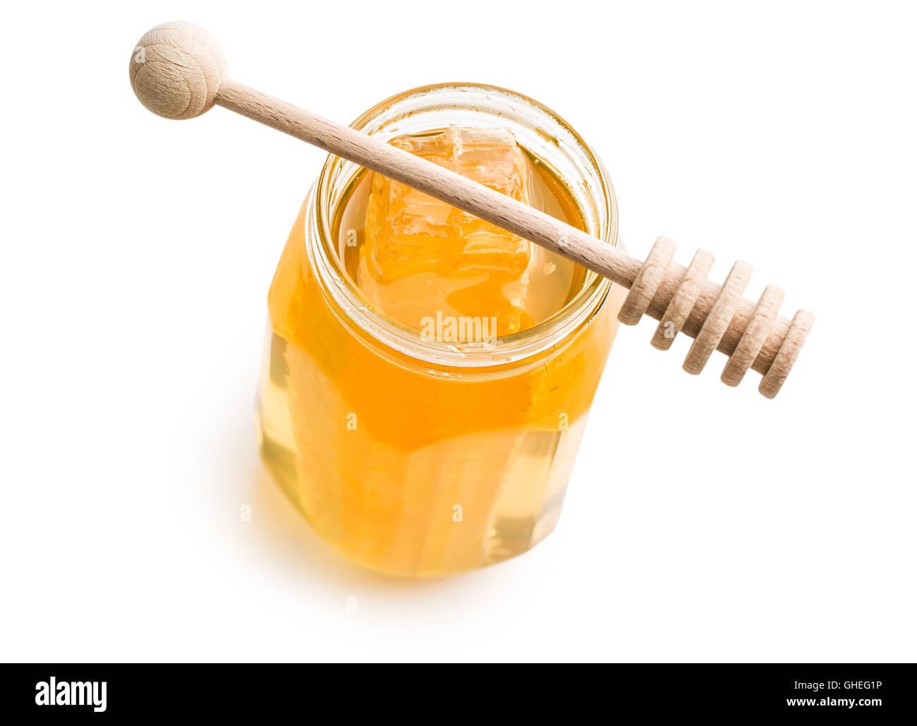 Fresh honey with honeycomb in jar. - Stock Image