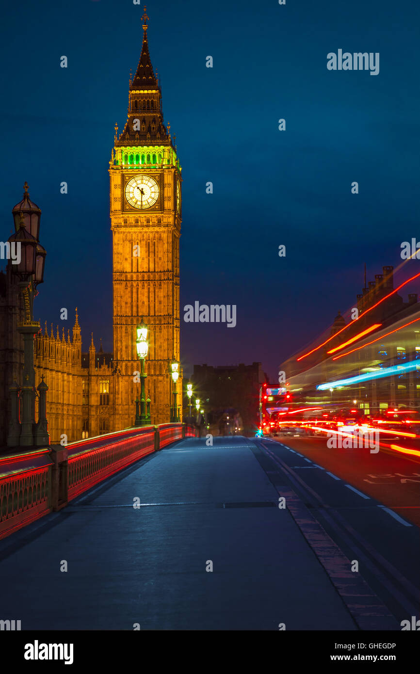 View of Big Ben from Westminster Bridge and night traffic. - Stock Image