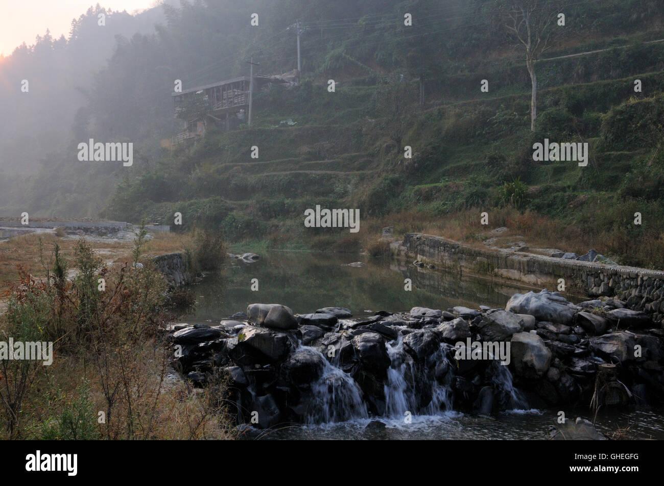 River and Fields in Zhaoxing, Guizhou, China Stock Photo