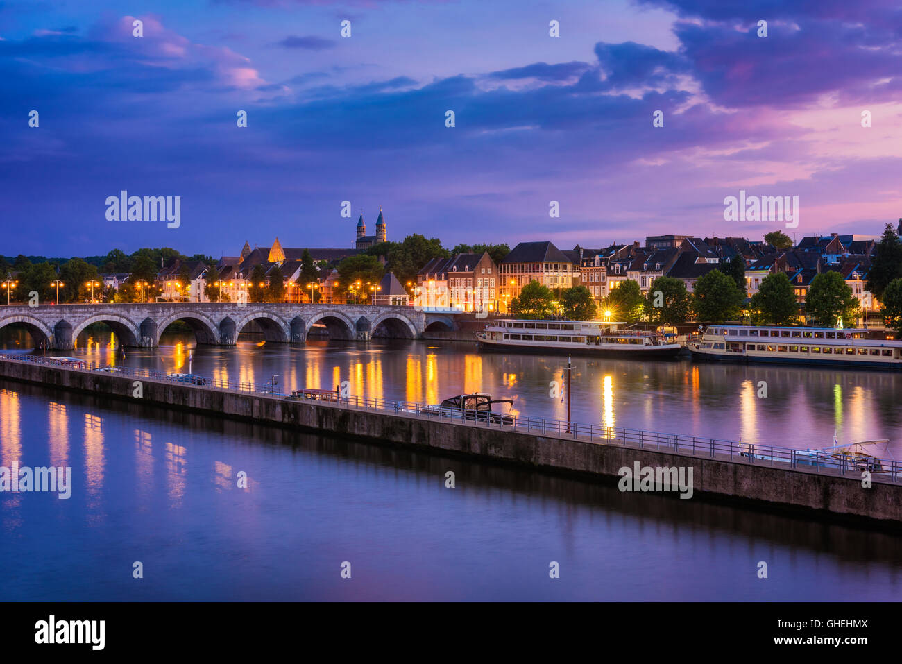 Maastricht and Maas River around sunset on summer evening - Stock Image