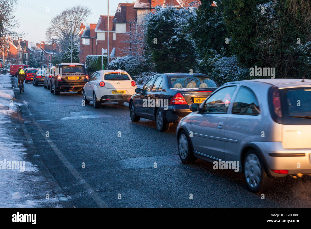 Morning rush hour traffic queueing in Winter in a residential area, Nottinghamshire, England, UK Stock Photo