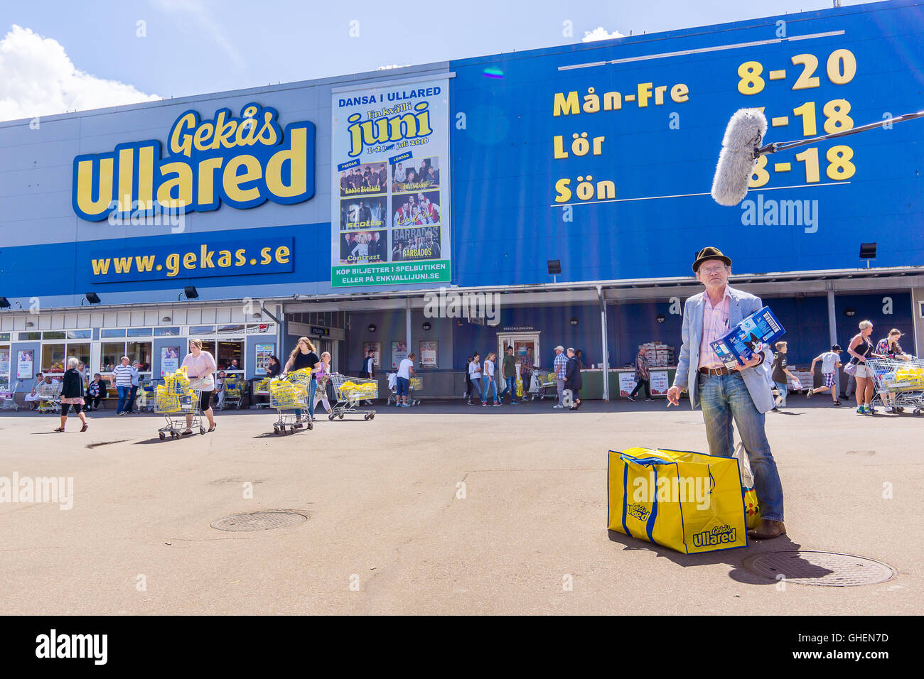 Swedish TV-team asking a man some questions in front of the department store GeKas at Ullared, Sweden - Stock Image