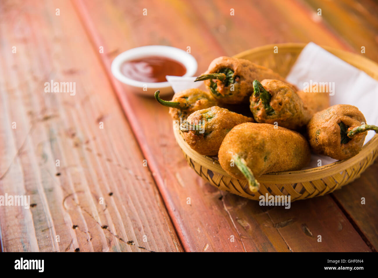 Chilli Pakora or mirch pakoda , An extremely delicious and mouth watering snack of Pakistani & Indian Pe - Stock Image